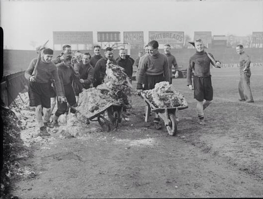 fulham-players-help-clear-the-snow-at-craven-cottage-before-their-cup-tie-against-bury-in-1939