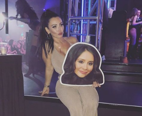 Jenni poses with a cut-out of Snooki at her birthday party.