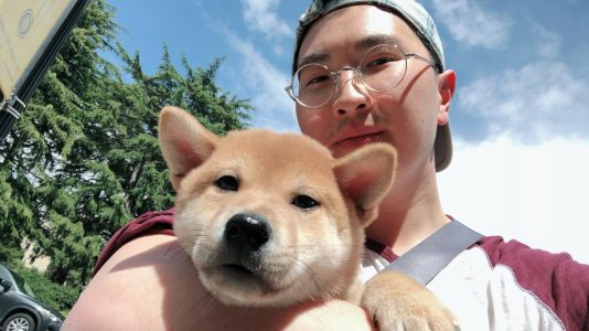 Chris Hu with his puppy OJ
