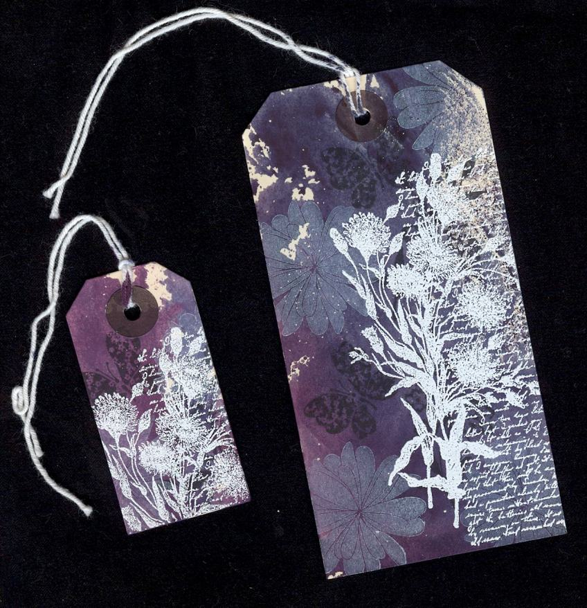 Two decorated luggage tags