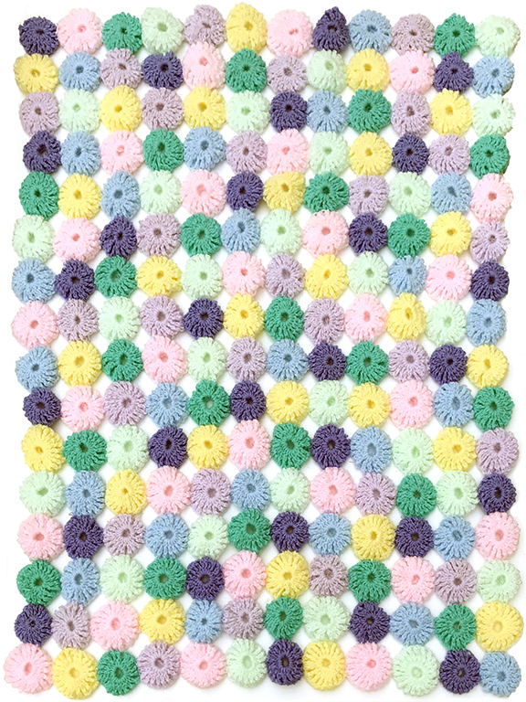 crocheted pompom blanket