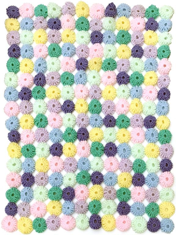 crocheted pompom blanket