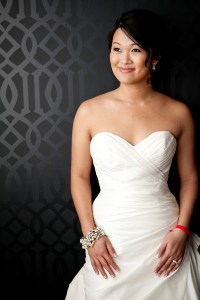 Associate Wedding Planner Huoy in wedding gown by Angela and Evan Photography