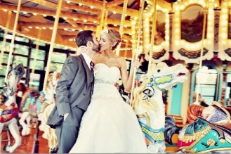 Seattle's Top Wedding Vendors | Bride and groom on carousel | Seattle's Best Hair and Makeup
