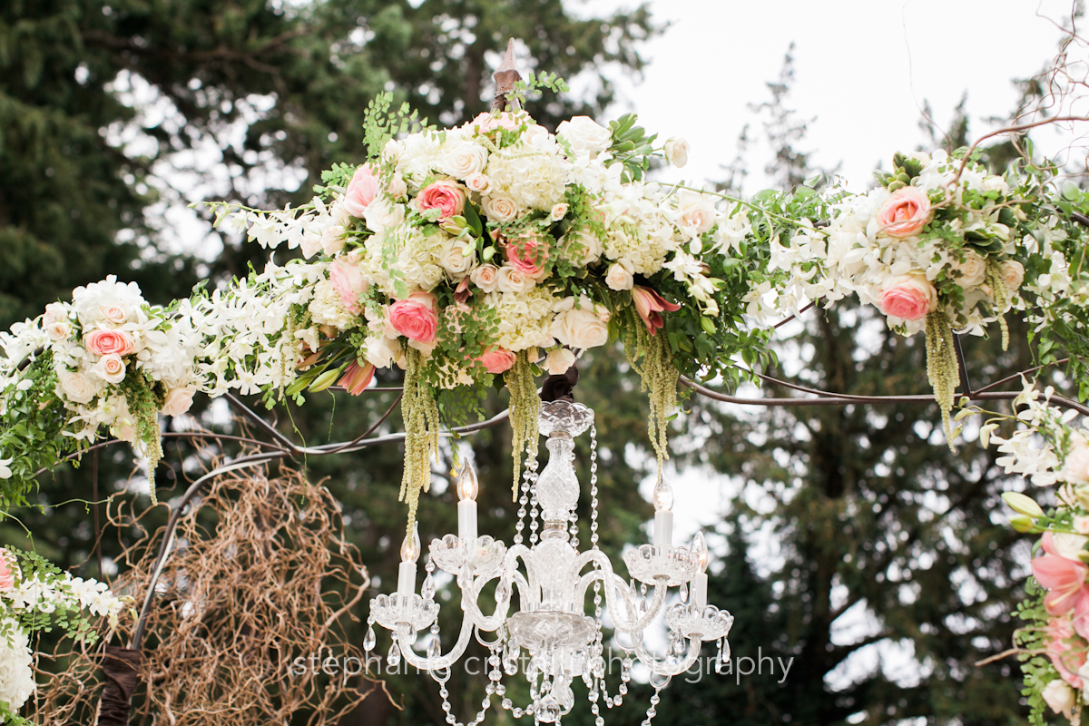 Thornewood Castle Wedding in Seattle   Breathtaking ceremony floral installment with crystal chandelier   Perfectly Posh Events, Seattle Wedding Planner   Stephanie Cristalli Photography   Aria Style