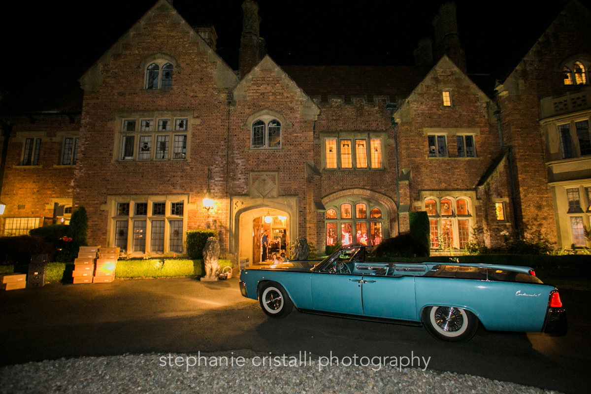 Thornewood Castle Wedding in Seattle   Blue Lincoln Continental Convertible get away car   Perfectly Posh Events, Seattle Wedding Planner   Stephanie Cristalli Photography