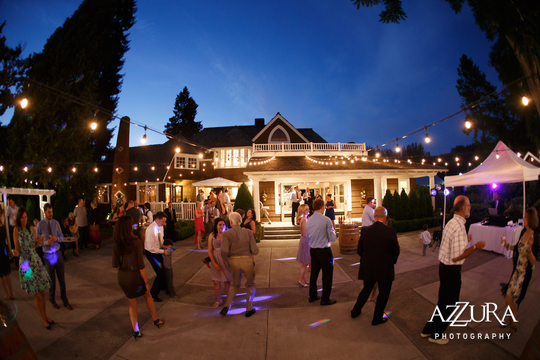 Laurel Creek Manor Wedding in Seattle | Evening dancing at Laurel Creek Manor with Italian cafe lights | Perfectly Posh Events, Seattle Wedding Planner | Azzura Photography