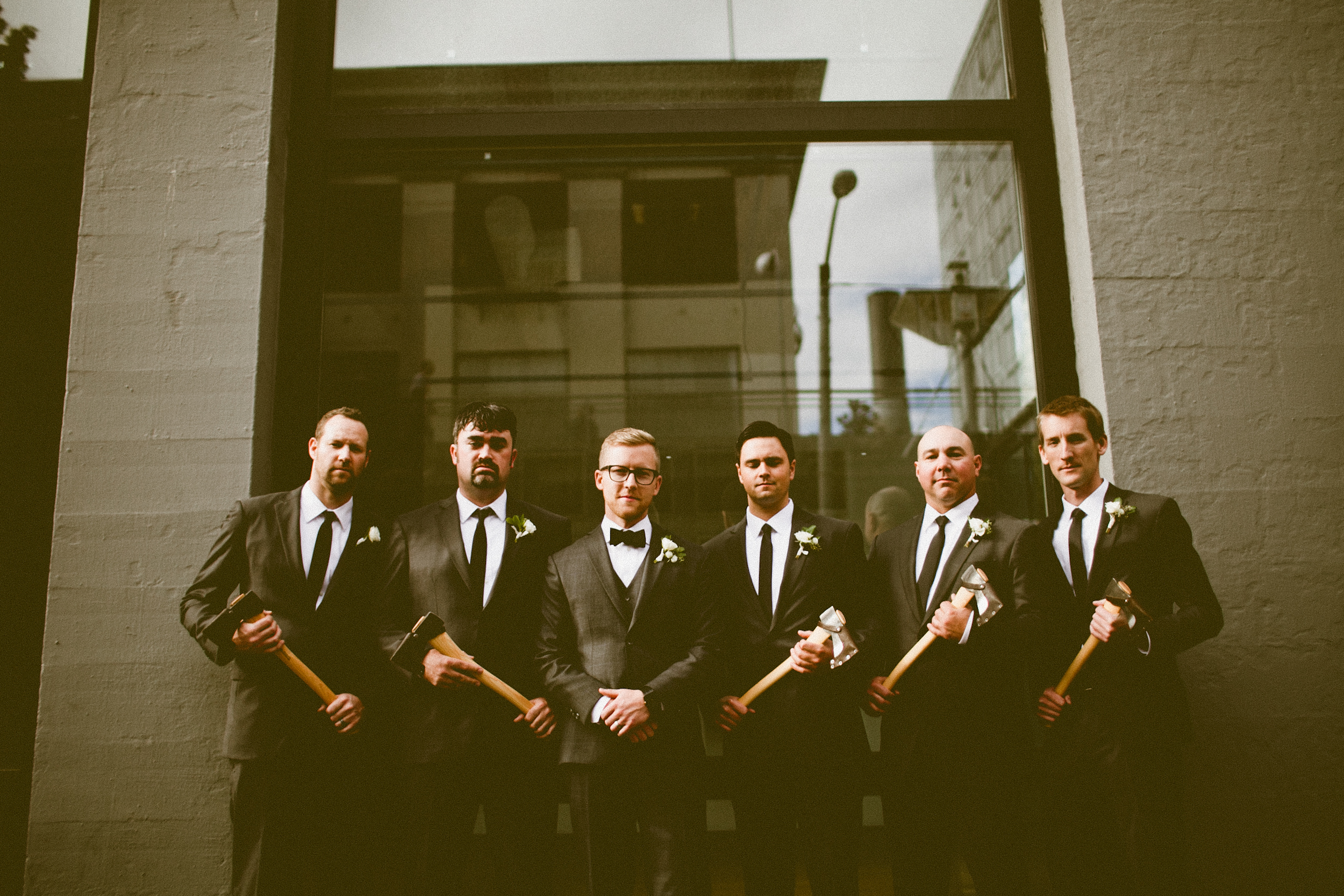 Sodo Park Wedding in Seattle   Groomsmen posing with groom and groomsmen gifts   Perfectly Posh Events, Seattle Wedding Planner   Andria Lindquist Photography