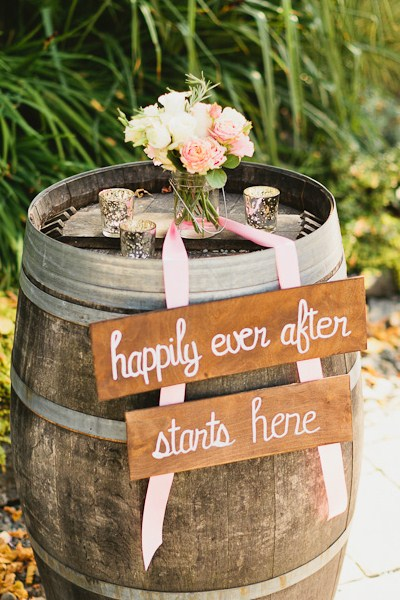 DeLille Cellars wedding in Woodinville   Rustic welcome sign on wine barrel   Perfectly Posh Events   Lucid Captures Photography   Bella Signature Design