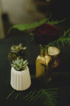 Cedarbrook Lodge wedding in Seattle | Succulent and fern centerpieces in mismatched small, ceramic and metallic vases for New Year's Eve wedding reception | Perfectly Posh Events | Carly Bish Photography | Butter & Bloom