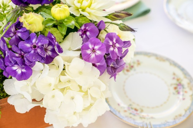 Planter box centerpieces with purple, white, and green florals with mismatched china and sage green napkins | Meadowbrook Farm Wedding, Snoqualmie, WA | Perfectly Posh Events, Seattle Wedding Planner | Down to Earth Flowers | Sasha Reiko Photography | Jesse + Wes Wedding // © Sasha Reiko Photography