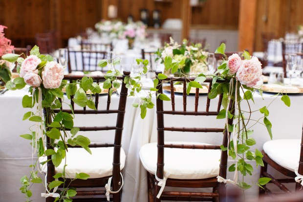 Kiana Lodge Real Wedding on Bainbridge Island | Real Wedding use of 2017 Pantone Color of the Year, Greenery | Peony and greenery garland for sweetheart chairs | Designed + Coordinated by Perfectly Posh Events | Amelia Soper Photography | Floral Design by Melanie Benson Florals