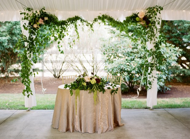 Laurel Creek Manor Wedding in Sumner   Sweetheart table with greenery installation backgrop   Design + Coordinated by Perfectly Posh Events   Katie Parra Photography   Floral Design by Flora Nova