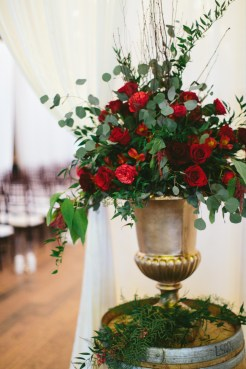 Sodo Park Wedding, Seattle WA   Elegant ceremony arrangement with burgundy blooms and lush greenery   2017 Pantone Color of the Year, Greenery   Designed + Coordinated by Perfectly Posh Events   Paige Jones Photography   Floral Design by Butter & Bloom