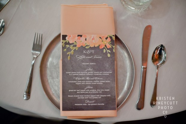 Melrose Market Studios Wedding in Seattle, WA | Peach and grey wedding with gray dinner menus on top of a peach napkin and aluminum plate | Wedding Planning by Perfectly Posh Events, Seattle Wedding Planner | Kristen Honeycutt Photography