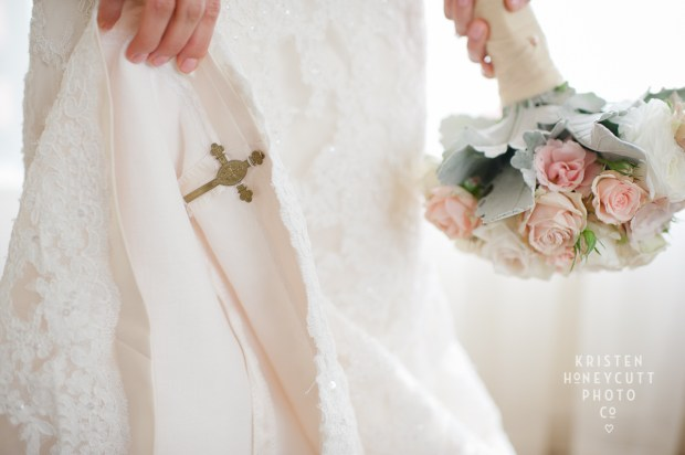 Melrose Market Studios Wedding in Seattle, WA | Cross brooch hidden in white lace wedding gown | Wedding Planning by Perfectly Posh Events, Seattle Wedding Planner | Kristen Honeycutt Photography | Floral Design by Contemporary Floral