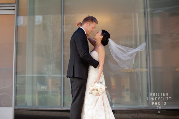 Melrose Market Studios Wedding in Seattle, WA | Creative ways to use veil in bridal portraits with bride and groom | Wedding Planning by Perfectly Posh Events, Seattle Wedding Planner | Kristen Honeycutt Photography | Floral Design by Contemporary Floral