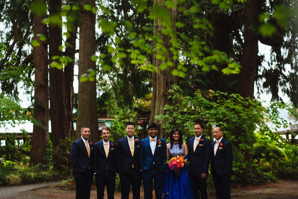 Kiana Lodge Wedding on Bainbridge Island, WA | Groomswoman in a navy gown and colorful bouquet amongst groom and groomsmen | Perfectly Posh Events, Seattle Wedding Planning | Shane Macomber Photography | Floral Design by Flora Nova