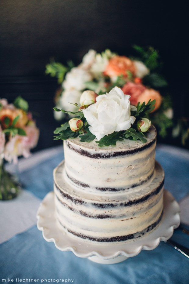 Hotel Ballard Wedding in Seattle, WA | Naked wedding cake with white and orange flowers | Perfectly Posh Events, Seattle Wedding Planner | Mike Fiechtner Photography | Floral Design by The London Plane | Cake by Stoneburner