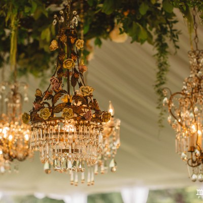 The Lodge in Fall City Wedding in Seattle, WA | Hanging chandelier and greenery installation in wedding reception tent | Perfectly Posh Events, Seattle Wedding Planner | Max & Sam Photography Floral Design by Sugar Pine | Chandeliers rented from Vintage Ambiance