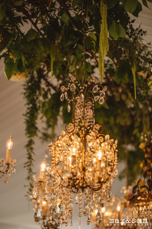 The Lodge at Fall City Wedding in Seattle, WA | Hanging chandelier and greenery installation in wedding reception tent | Perfectly Posh Events, Seattle Wedding Planner | Max & Sam Photography Floral Design by Sugar Pine | Chandeliers rented from Vintage Ambiance