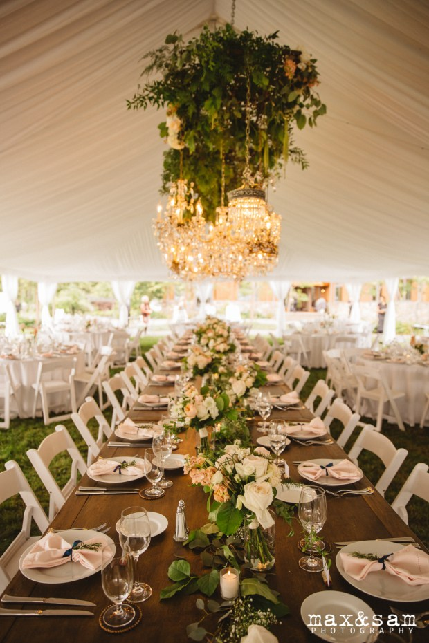 The Lodge at Fall City Wedding in Seattle, WA | Hanging chandelier installation with greenery above head table in reception tent | Perfectly Posh Events, Seattle Wedding Planner | Floral Design by Sugar Pine | Chandeliers rented from Vintage Ambiance | Max & Sam Photography