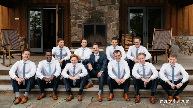The Lodge at Fall City Wedding in Seattle, WA | Casual groom and groomsmen portrait in front of rustic lodge | Perfectly Posh Events, Seattle Wedding Planner | Max & Sam Photography