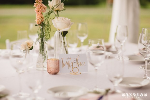 The Lodge at Fall City Wedding in Seattle, WA | Simple bud vase centerpiece with white and blush blooms and gold calligraphy table numbers | Perfectly Posh Events, Seattle Wedding Planner | Floral Design by Sugar Pine | Max & Sam Photography