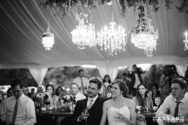 The Lodge at Fall City Wedding in Seattle, WA | Black and white photo of bride and groom listening to toasts under chandeliers | Perfectly Posh Events, Seattle Wedding Planner | Max & Sam Photography