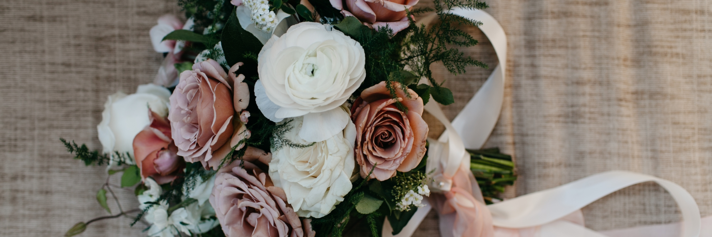 Wedding bouquet in dusty pink and white from Seattle wedding at Sodo Park with Perfectly Posh Events, Seattle + Portland wedding planner | Photo by Kate Price Photography