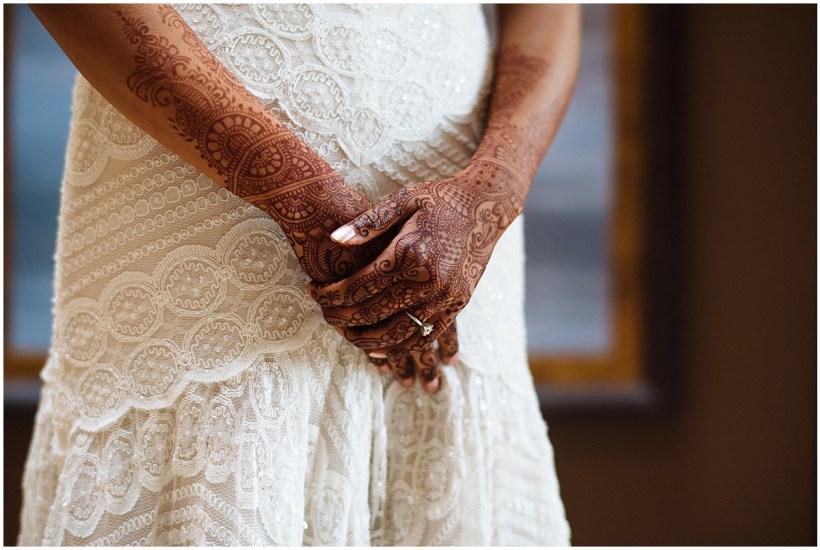 White laced scalloped dress with henna tattooed hands   Kiana Lodge Wedding, Bainbridge Island, WA   Perfectly Posh Events: Seattle + Portland Wedding Planners   Shane Macomber Photography