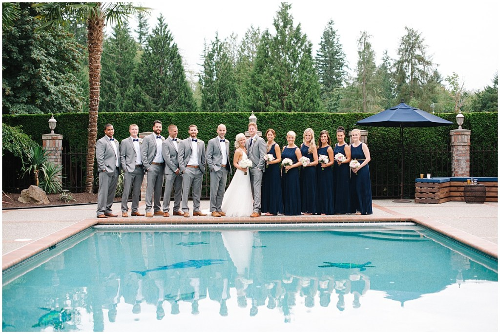 Wedding party in long navy bridesmaid dresses and light grey suits, Private Estate Wedding in Woodinville, Wedding Planning and Design by Perfectly Posh Events: Seattle and Portland Wedding Planner, Photo by Blue Rose Photography