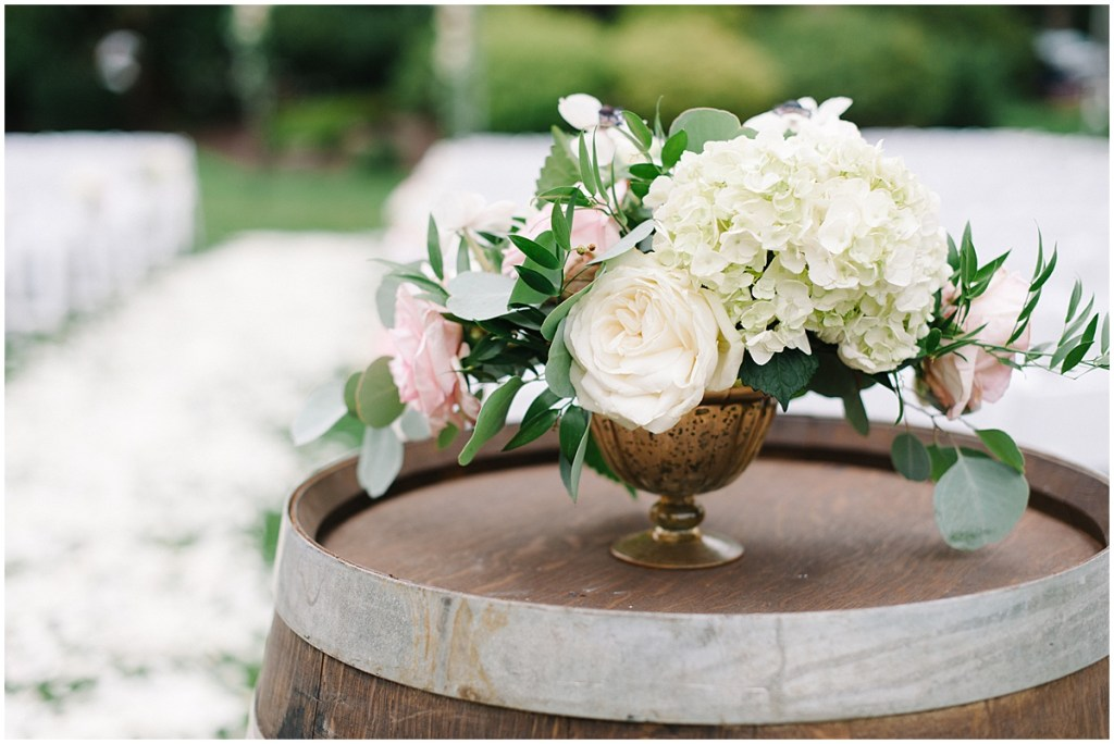 Wedding ceremony flowers white hydrangea and pink roses wine barrel | Private Estate Wedding in Woodinville | Wedding Planning and Design by Perfectly Posh Events: Seattle and Portland Wedding Planner | Photo by Blue Rose Photography