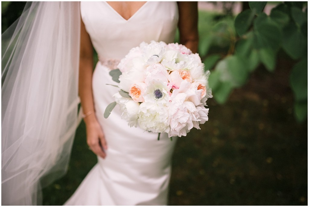 Bride in white gown poses with ivory and blush colored flower bouquet, Axis Pioneer Square wedding, Seattle wedding, Perfectly Posh Events, Seattle Wedding Planner, Photo by Roland Hale