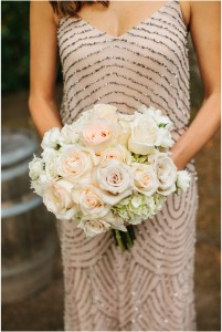 Bridesmaid in a sequined, champagne colored gown holding a blush and ivory floral bouquet, Seattle wedding, Perfectly Posh Events wedding planning and design, Seattle and Portland Wedding Planner, Photo by Lucid Captures Photography