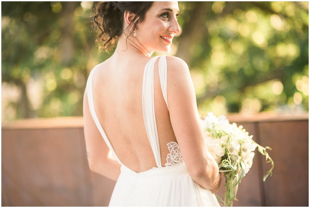 Bride in white backless wedding gown, Fremont Foundry wedding in Seattle, Wedding Planning and Design by Perfectly Posh Events, Seattle and Portland Wedding Planner, Photo by Alexandra Grace Photography