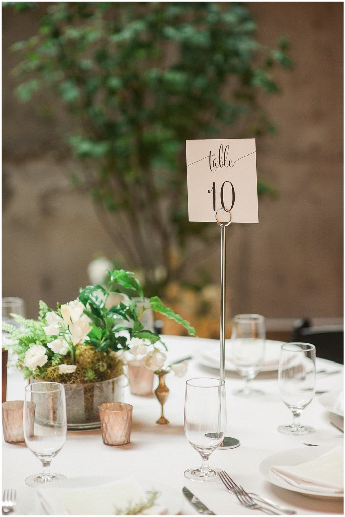 White and green floral centerpiece with table number, Fremont Foundry wedding in Seattle, Wedding Planning and Design by Perfectly Posh Events, Seattle and Portland Wedding Planner, Photo by Alexandra Grace Photography, flowers by Studio 3 Floral Design