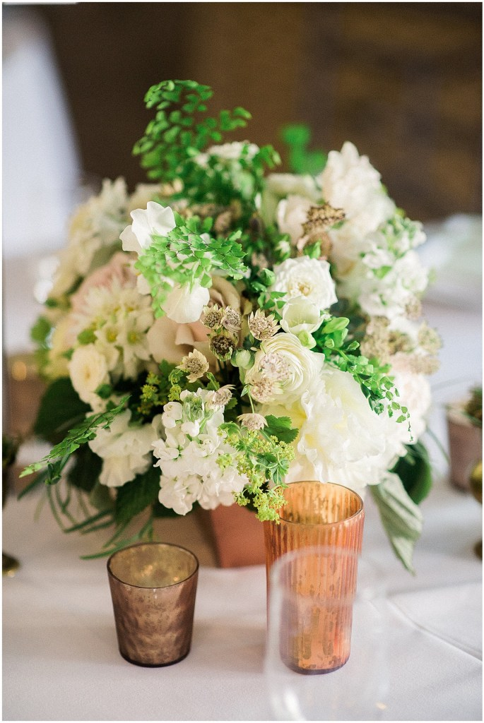 White and green centerpiece in copper vase, Fremont Foundry wedding in Seattle, Wedding Planning and Design by Perfectly Posh Events, Seattle and Portland Wedding Planner, Photo by Alexandra Grace Photography, Flowers by Studio 3 Floral Design