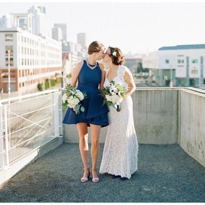 Metropolist Wedding in Seattle, WA | Same sex brides with navy accents, like a fur shawl, shoes, and dress | Seattle Wedding Planner, Perfectly Posh Events | Katie Parra Photography | Floral Design by Sublime Stems
