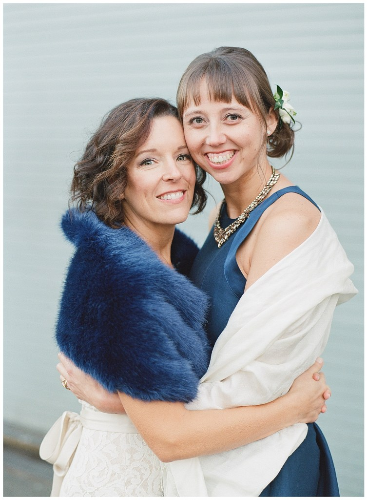 Metropolist Wedding in Seattle, WA | Same sex brides with navy accents, like a fur shawl, shoes, and dress | Seattle Wedding Planner, Perfectly Posh Events | Katie Parra Photography