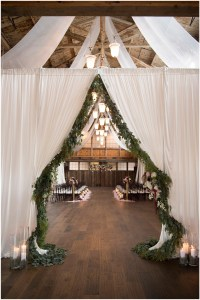 White curtains draped with greenery opening to rustic indoor wedding ceremony, Seattle wedding at Sodo Park, Perfectly Posh Events wedding planning and design, Seattle and Portland Wedding Planner, Photo by Kimberly Kay Photography