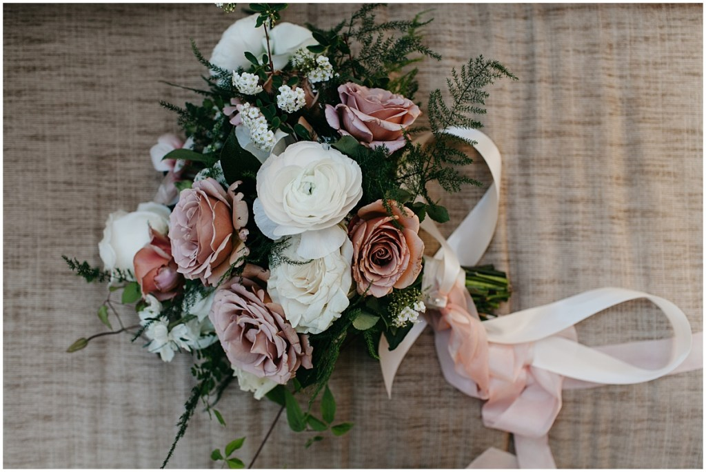 Large bouquet with white and blush colored flowers and touches of greenery, Sodo Park wedding, Seattle wedding, Perfectly Posh Events wedding planning and design, Seattle and Portland Wedding Planner, Photo by Kate Price Photography