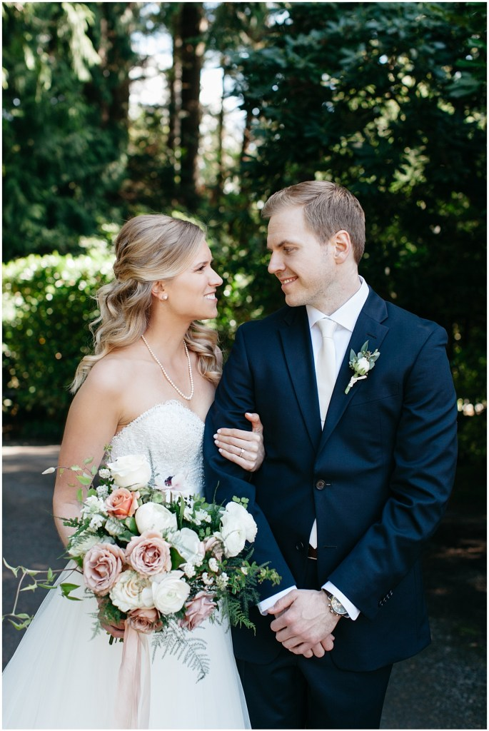 Bride and groom lovingly gaze at one another while posing outside, Sodo Park wedding, Seattle wedding, Perfectly Posh Events wedding planning and design, Seattle and Portland Wedding Planner, Photo by Kate Price Photography