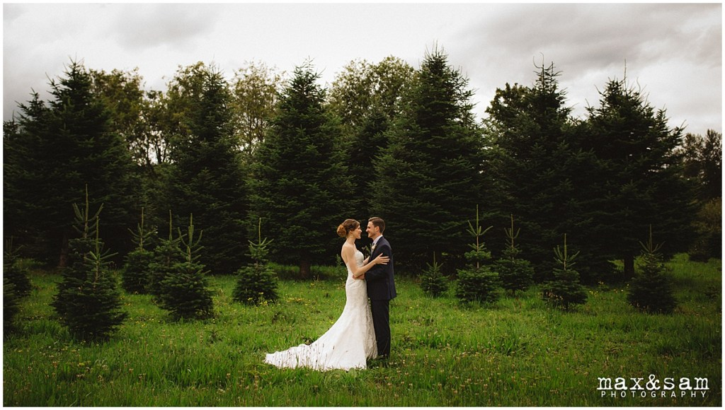 Bride and groom embrace each other while posing in front of pine trees, The Lodge at Fall City wedding, Seattle wedding, planning and design by Perfectly Posh Events, Seattle Wedding Planner, Photo by Max & Sam Photography