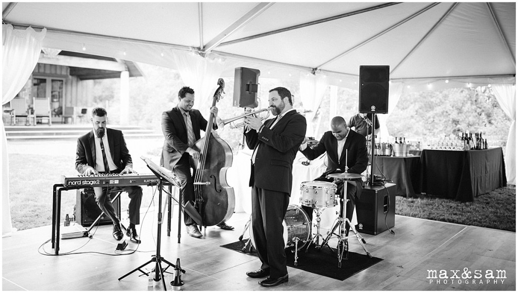 Black and white photo of four piece band playing at wedding reception, The Lodge at Fall City wedding, Seattle wedding, planning and design by Perfectly Posh Events, Seattle Wedding Planner, Photo by Max & Sam Photograph