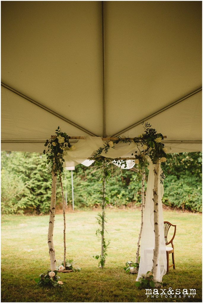 Rustic wood altar decorated with flowers, greenery, and draped with white fabric, The Lodge at Fall City wedding, Seattle wedding, planning and design by Perfectly Posh Events, Seattle Wedding Planner, Photo by Max & Sam Photography