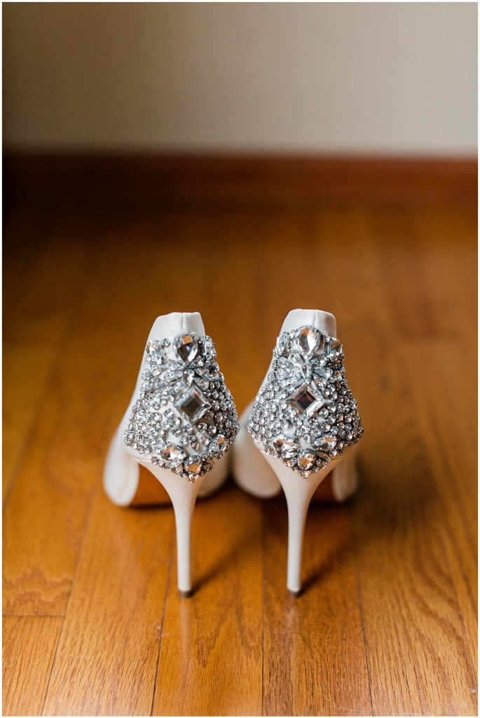 Close up of back of bride's shoes in ivory satin and embellished with jewels by Ted Baker, Admiral's House wedding, Seattle wedding, wedding planning by Perfectly Posh Events, Seattle Wedding Planner, Photo by Michele M. Waite Photography