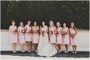 Bride in an ivory colored ball gown wedding dress poses with her bridesmaids wearing light pink mid-length cocktail dresses, mid century modern wedding, The Foundry by Herban Feast wedding, Seattle wedding, Perfectly Posh Events wedding planning and coordination, Photo by Carina Skrobecki
