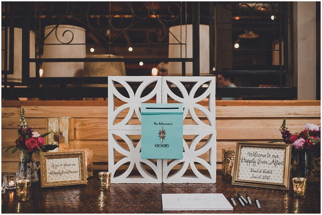 Decorated table set up with a wedding guestbook and a teal blue card box, mid century modern wedding, The Foundry by Herban Feast wedding, Seattle wedding, Perfectly Posh Events wedding planning and coordination, Photo by Carina Skrobecki