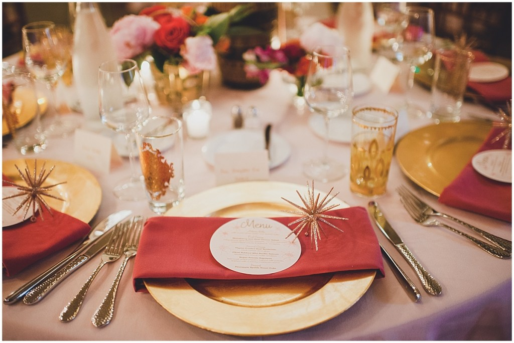 Wedding reception table setting with a gold charger plate and red napkins, Mid Century modern wedding,The Foundry by Herban Feast wedding, Seattle wedding, Perfectly Posh Events wedding planning and coordination, Photo by Carina Skrobecki